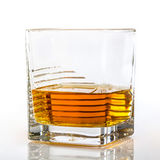 Glass of whiskey or scotch. On white background Stock Images