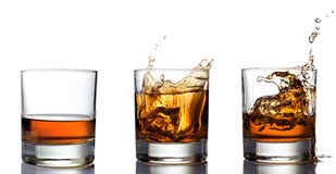 Glass of whiskey solated on white background Royalty Free Stock Image
