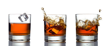 Glass of whiskey solated on white background Stock Images