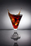 Glass with whiskey splash Royalty Free Stock Photo