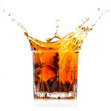 Glass with whiskey splash Stock Photo