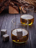 Glass of whiskey with stones. Selective focus Royalty Free Stock Images