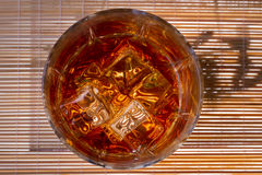 Glass of whiskey. Glass tumbler of whiskey with ice cubes Stock Images