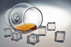 Glass of whiskey. Glass tumbler of whiskey with ice cubes Stock Photos