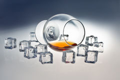 Glass of whiskey. Glass tumbler of whiskey with ice cubes Stock Photography