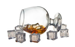 Glass of whiskey. Glass tumbler of whiskey with ice cubes Stock Photo