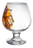 Glass of whiskey. Glass tumbler of whiskey with ice cubes Royalty Free Stock Photography