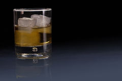 Glass of Whisky. Double scotch whisky with 3 ice cubes Royalty Free Stock Images