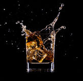 Glass with whisky Stock Images