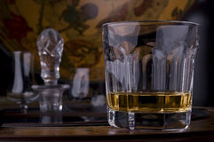 Glass of whisky alcohol. Crystal glass of whisky alcohol on a fancy bar Royalty Free Stock Image