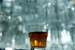 Glass of whisky on a bar table Stock Image