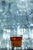 Glass of whisky on a bar table Stock Images