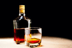 Glass of whisky and bottle Royalty Free Stock Image