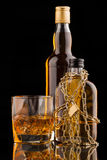 Glass and whisky bottles Royalty Free Stock Images