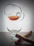 Glass whisky brandy cognac Cuban cigar background light gradient luster Stock Images