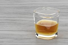 Glass of whisky on wood background Stock Photos