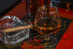 Glass of whisky and cigar Stock Photo