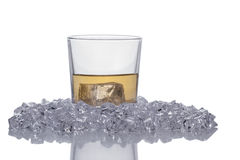 Glass of Whisky. A Glass of Whisky with Crushed Ice Around Isolated on a White Background stock image