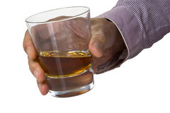 Glass of whisky is in the hand Royalty Free Stock Photo