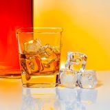 Glass of whisky with ice Stock Image