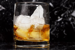 Glass of whisky over dark Stock Images
