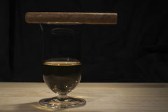 Glass with whisky standing on a wooden table Stock Photography