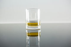 Glass of whisky on table Royalty Free Stock Image