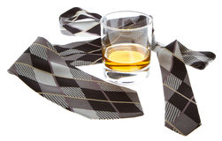 Glass of whisky and a tie Royalty Free Stock Images