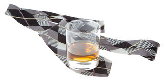 Glass of whisky and a tie Stock Photo