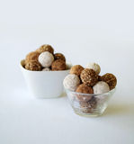 A glass and white bowl with a assortment of truffle chocolates, Royalty Free Stock Photos