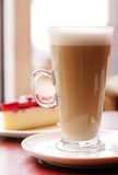A glass of white coffee on a plate Stock Photo