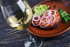 A glass of white dry wine with steak stock image