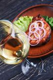 A glass of white dry wine with steak stock photo
