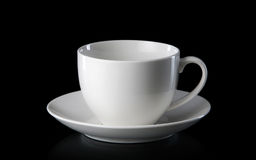 Glass. White empty coffee cup isolated on black background Royalty Free Stock Photo