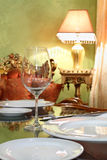 Glass and white plates at table in restaurant Royalty Free Stock Image
