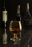 Glass with white, red wine and cognac or whisky on mirror table. Celebrities composition. selective focus Stock Photography
