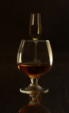 Glass with white, red wine and cognac or whisky on mirror table. Celebrities composition. selective focus Royalty Free Stock Photos