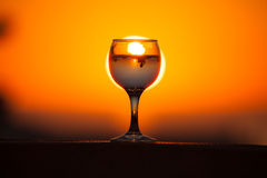 Glass of white vine with reflections of houses and view to beaut Stock Images