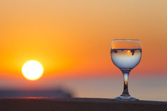 Glass of white vine with reflections of houses and view to beaut Royalty Free Stock Image