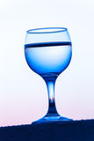 Glass of white vine with reflections of houses and view to beaut Royalty Free Stock Images