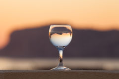 Glass of white vine with reflections of houses and view to beaut Stock Photos