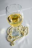 Glass of white vine on the table Royalty Free Stock Images