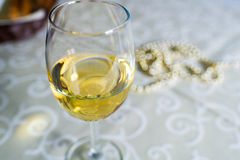 Glass of white vine on the table Stock Image