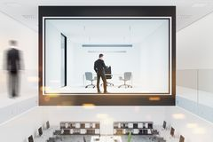 Glass and white wall boss office interior toned. Glass and white wall boss office interior in a two floor building with a large table and an office chair Stock Photography