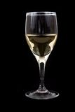 A glass of white wine. Photographed on black background Royalty Free Stock Photos