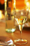 Glass of white wine. On a celebratory table Royalty Free Stock Image