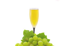 Glass of white wine. And grapes isolated on a white background Royalty Free Stock Photo