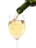 Glass white Wine. White wine being poured into a wine glass Stock Photo