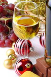 Glass of white wine. Glass with wine on a white background and Christmas decorations Stock Image