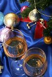 Glass of white wine on a beautiful christmas background Royalty Free Stock Photo